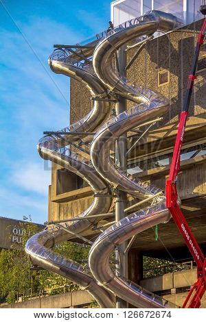 LONDON UK - JUNE 6 2015: Repair Work Using Crane on metal spiral pipe for fire brigade downhill