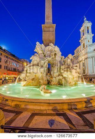 Illuminated at night the Fiumi Fountain on Piazza Navona, Rome, Italy.
