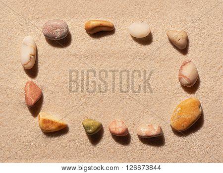 Rectangular Frame Of Sea Stones On Sand
