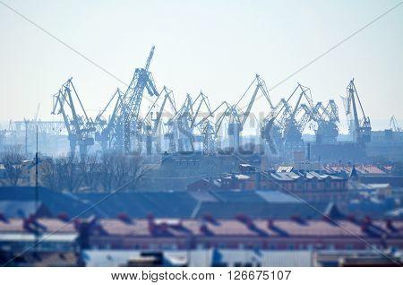 Birds eye view of cargo crane in port of Saint-Petersburg Russia - urban landscape in sunny weather