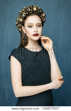 Portrait of a beautiful young woman in a wreath on had. Beauty female. Perfect skin and make up.