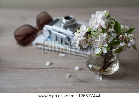Closeup of spring flowers on table with camera