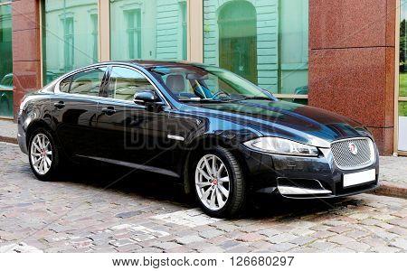 SZCZECIN, POLAND - April 19, 2015: Jaguar luxury sedan on the street in Szczecin, Poland