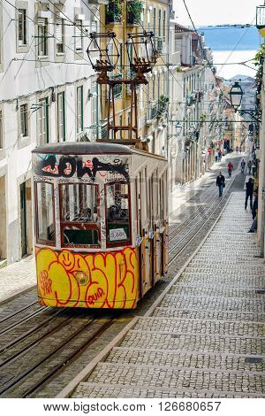 LISBON PORTUGAL - FEBRUARY 01 2016: Vintage Lisbon street and traditional funicular Portugal