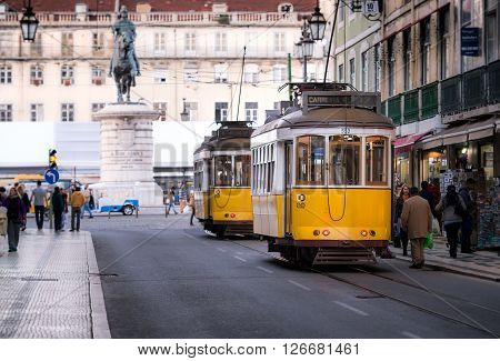 LISBON PORTUGAL - FEBRUARY 01 2016: Old Lisbon street and traditional yellow tram Portugal