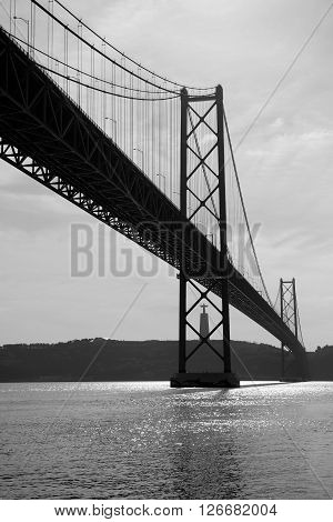 The 25 de Abril Bridge is a suspension bridge connecting the city of Lisbon capital of Portugal to the municipality of Almada on the left (south) bank of the Tejo river.
