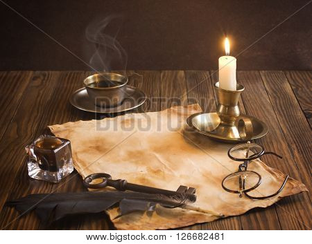 Vintage letter concept (cup of coffee, old paper, candle and feather)