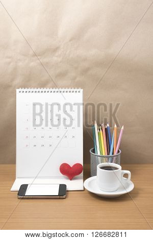 office desk,coffee with phone calendar heart on wood background