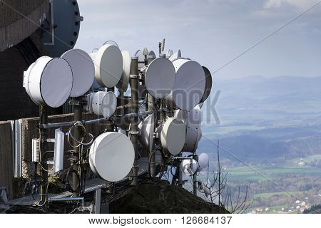 Bunch Of Transmitters And Aerials On The Telecommunication Tower