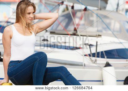 Attractive Woman Sitting On Marina