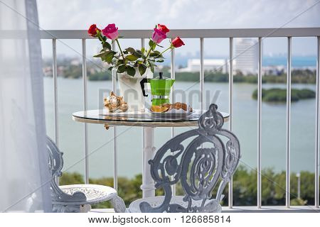 Breakfast With Coffee On Terrace Decorated With Flowers