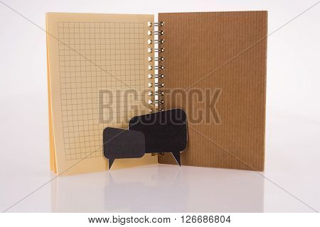 Dialogue boxes near a notebook on a white background