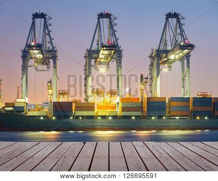 Cargo ship and crane at port twilight time.