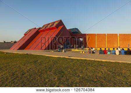 LAMBAYEQUE PERU - August 2 2012: Several tourists waiting to enter the Royal Tombs of Sipan Museum in Lambayeque Peru on August 2 2012