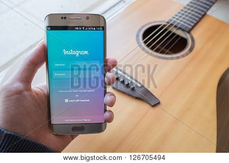 CHIANG MAI THAILAND - FEB 01 2016: A man hand holding screen shot of Instagram application using samsung galaxy s6 edge. Instagram is largest and most popular photograph social networking.