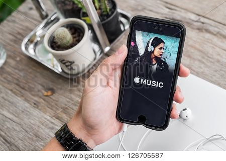 CHIANG MAITHAILAND - DEC 4 2015: A man hand holding screen shot of Apple music app showing on iPhone 6. Apple Music is the new iTunes-based music streaming service that arrived on iPhone.