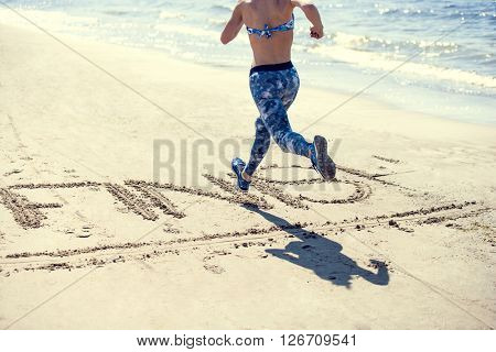 female runner jogging, beach workout, fit model, sunny summer day