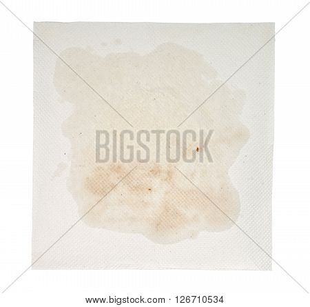 Used paper towel with oil stain isolated on white background