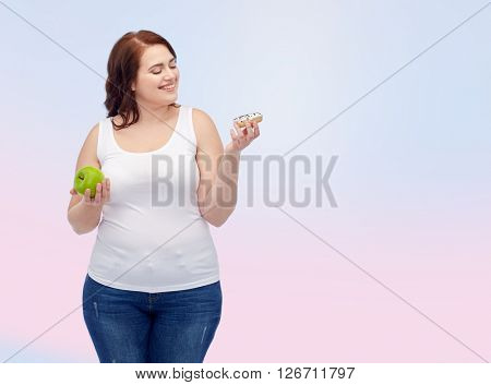 healthy eating, junk food, diet and choice people concept - smiling plus size woman choosing between apple and donut over rose quartz and serenity gradient background