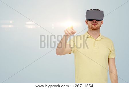 3d technology, virtual reality, entertainment and people concept - young man with virtual reality headset or 3d glasses playing game over gray background