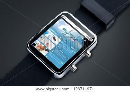 modern technology, object, business, internet and mass media concept - close up of smart watch with news web page on screen