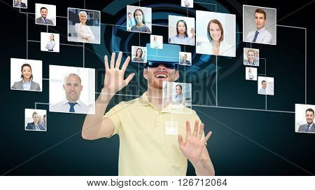 3d technology, virtual reality, cyberspace, entertainment and people concept - happy young man with virtual reality headset or 3d glasses working with business contacts icons over black background