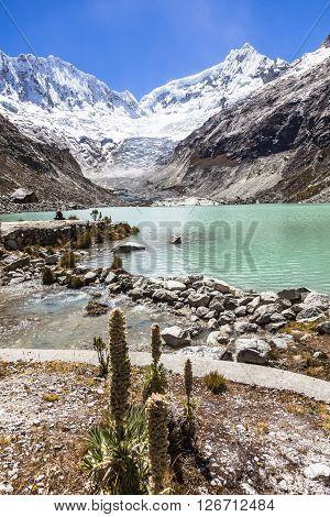 Llaca lagoon (4474 m) in the peruvian Andes and Ocshapalpa peak (5888 m) and Ranrapalca peak (6162 m) Peru