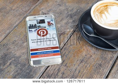 CHIANG MAI THAILAND - MAR 6 2016: Samsung galaxy S6 edge with Pinterest application on the screen. Pinterest is an online pinboard that allows people to pin their interesting things.