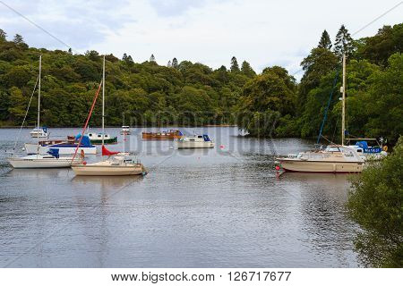 SCOTLAND,UK - AUGUST 15, 2015: Boats in Scottish loch. Panorama from Scotland