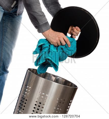 Young Man Putting A Dirty Towel In A Laundry Basket