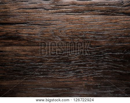 Wooden background painted in the dark brown colour.