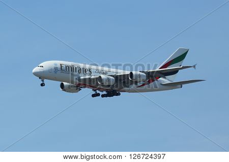 NEW YORK - APRIL 21, 2016:Emirates Airline Airbus A380 descending for landing at JFK International Airport in New York. The Airbus A380 is a double-deck, wide-body, world's largest passenger airliner