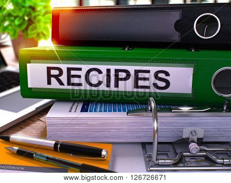 Recipes - Green Ring Binder on Office Desktop with Office Supplies and Modern Laptop. Recipes Business Concept on Blurred Background. Recipes - Toned Illustration. 3D Render.