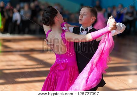 Minsk Belarus -April 3 2016: Unidentified Dance Couple Performs Youth-2 Standard Program on the IDSA Championship Kinezis Star Cup - 2016 in April 3 2016 in Minsk Republic of Belarus