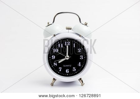 White Classic Alarm Clock On White Background