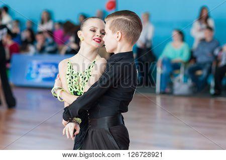 Minsk Belarus -April 3 2016: Novikov Yaroslav and Murza Alina Perform Juvenile-1 Latin-American Program on the IDSA Championship Kinezis Star Cup - 2016 in April 3 2016 in Minsk Republic of Belarus ** Note: Soft Focus at 100%, best at smaller sizes