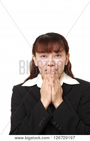 studio shot of Asian businesswoman pleasedon white background