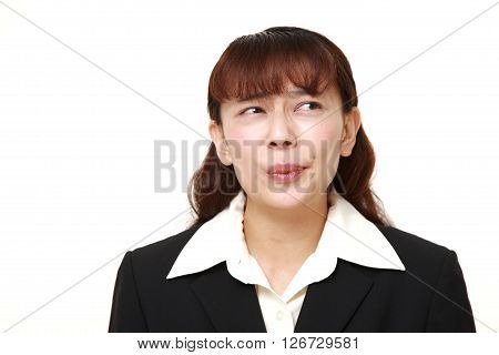 Asian businesswoman worries about something on white background