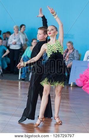 Minsk Belarus -April 3 2016: Novikov Yaroslav and Murza Alina Perform Juvenile-1 Latin-American Program on the IDSA Championship Kinezis Star Cup - 2016 in April 3 2016 in Minsk Republic of Belarus