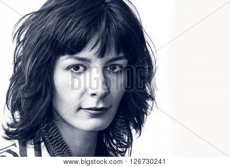 Vintage style portrait of a young woman in a striped shirt