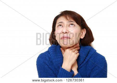 studio shot of Asian woman having throat pain on white background