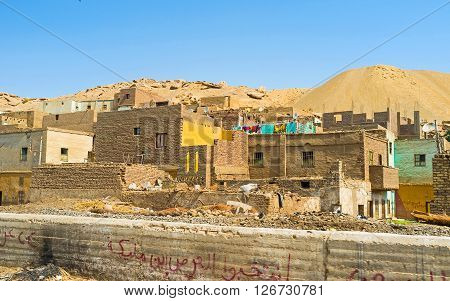 The towns and villages of Upper Egypt are full of unfinished houses slums spontaneous rubbish dumps.