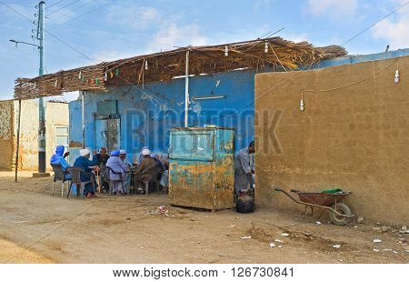 NAJ' AT TUNAB EGYPT - OCTOBER 6 2014: The company of elderly men sits in the shady terrace of the village teahouse on October 6 in Naj' At Tunab.