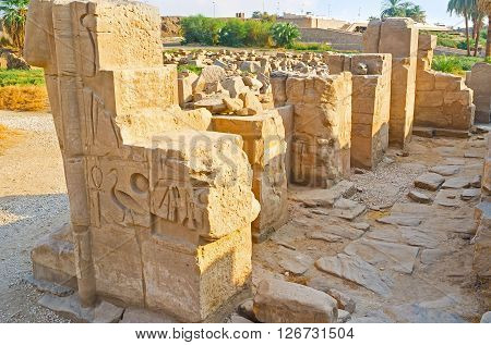 The remains of the ancient wall covered with Egyptian hieroglyphs Karnak Temple Luxor Egypt.