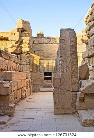 LUXOR EGYPT - OCTOBER 7 2014: The side chambers of Khonsu Temple with the remains of reliefs on the walls Karnak Complex on October 7 in Luxor.
