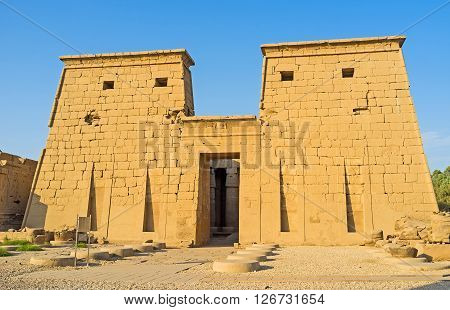 LUXOR EGYPT - OCTOBER 7 2014: The facade of Khonsu Temple decorated with the sacred cobras relief over the entrance gate Karnak Complex  on October 7 in Luxor.