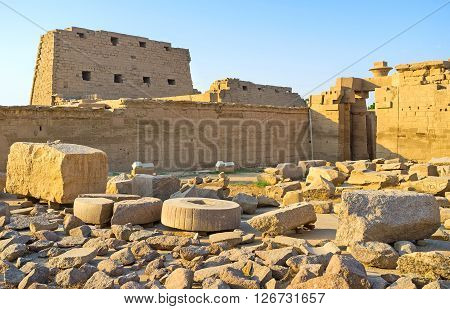 LUXOR EGYPT - OCTOBER 7 2014: The view on the high wall of the First Pylon from the backyard Karnak Temple on October 7 in Luxor.