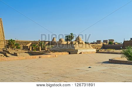 The ruins in front of the First Pylon of Karnak Temple and the old mosque in the middle Luxor Egypt.