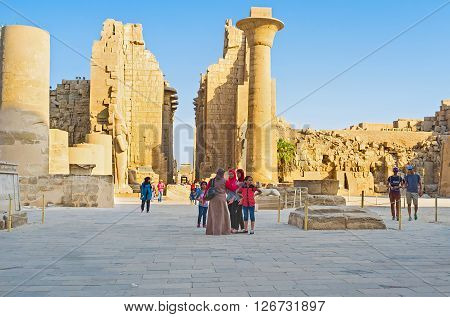 LUXOR EGYPT - OCTOBER 7 2014: The courtyard of the Karnak Temple with the view on the East Second Pylon columns and statues of ancient pharaohs on October 7 in Luxor.