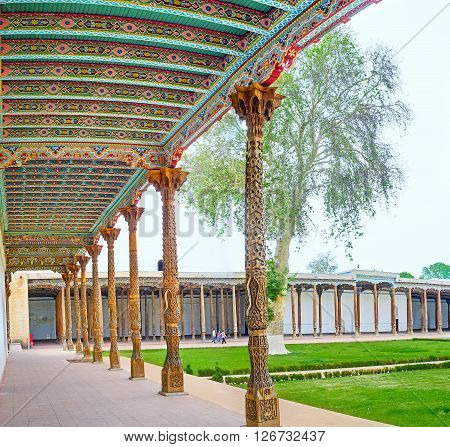 KOKAND UZBEKISTAN - MAY 6 2015: The courtyard of the Jami Mosque with beautiful carved pillars and painted canopy on May 6 in Kokand.